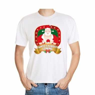 Foute kerst shirt santa is almost coming heren