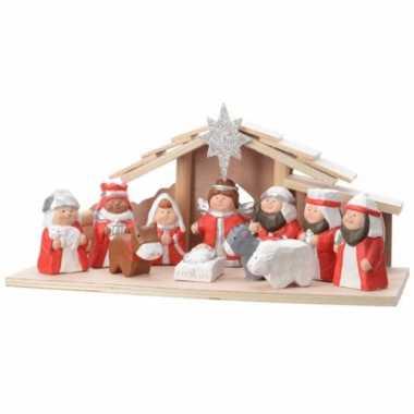 Kerststal met rood/witte figuren